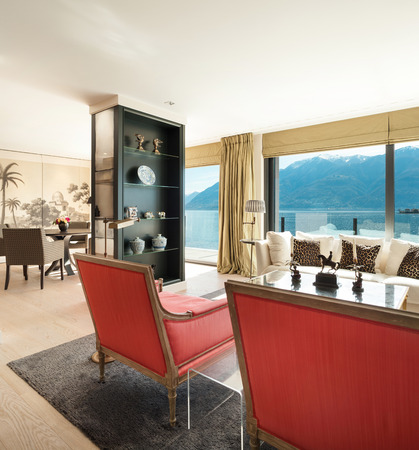 view of an elegant red couch: modern architecture, Interior, beautiful penthouse, living room