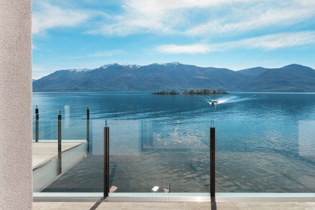 balcony view: modern architecture, beautiful lake view from the terrace of a penthouse Stock Photo