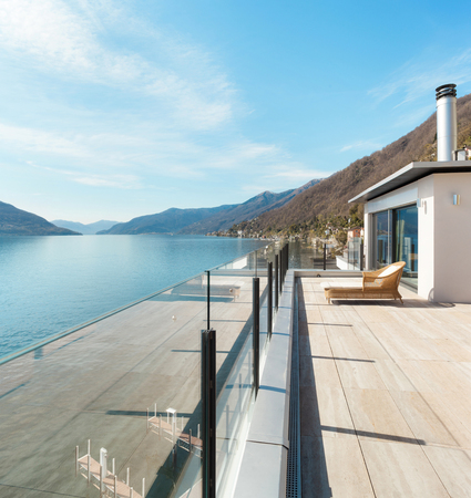 contemporary house: modern architecture, beautiful lake view from the terrace of a penthouse Stock Photo