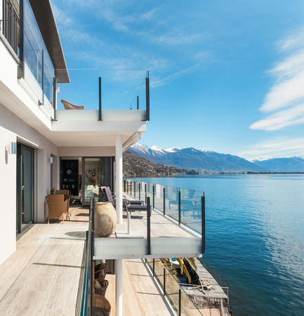 modern architecture: modern architecture, beautiful lake view from the terrace of a penthouse Stock Photo