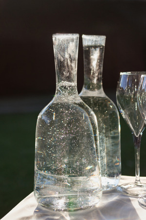 Mineral: bottles of mineral water and glass