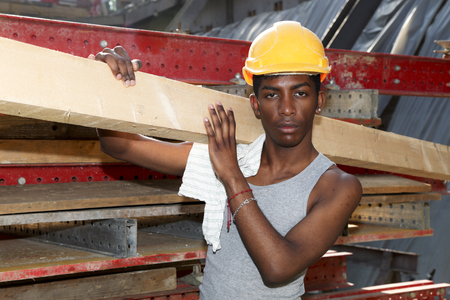 displace: young black man working in construction site Stock Photo