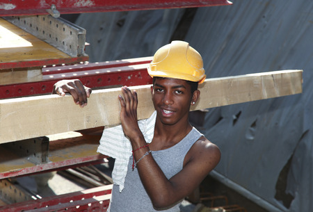 construction workers: young black man working in construction site Stock Photo