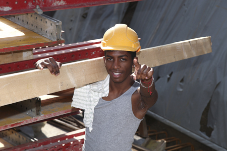 work safety: young black man working in construction site Stock Photo