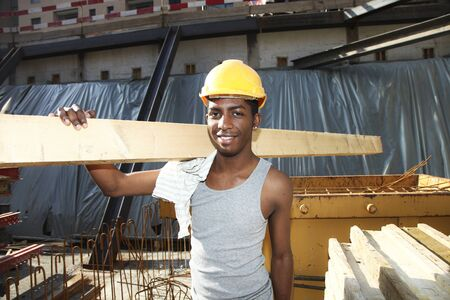 work wear: young black man working in construction site Stock Photo