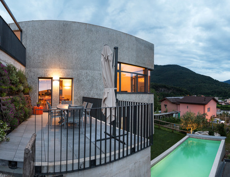 modern home: external of a modern house with pool, evening scene