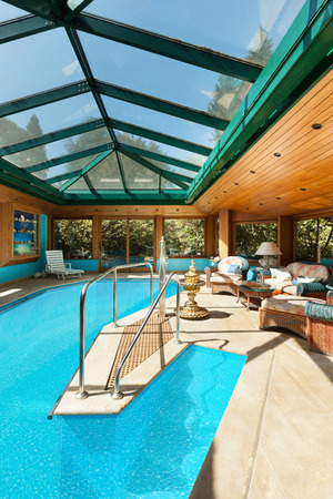 skylights: Interior of a residential house, wide indoor pool with skylights