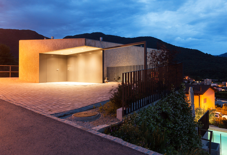 modern building: entrance of a modern building by night Stock Photo