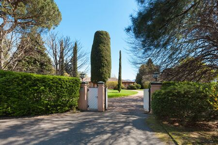 cielos abiertos: gate of a beautiful house in a sunny spring day