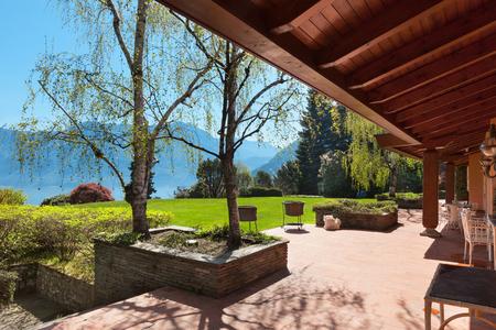 veranda: veranda of a villa with garden in a sunny spring day