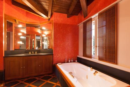 bathroom interior: Interior house, comfortable bathroom, red walls