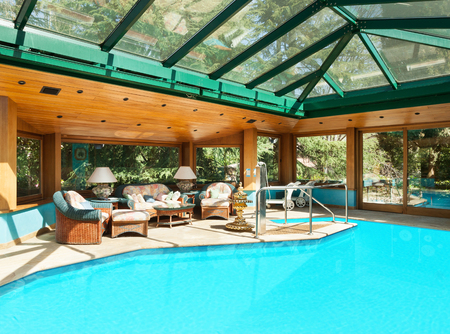 skylights: Interior of a residential house, large indoor pool, ceiling with skylights Stock Photo