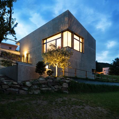housing styles: external of a modern house, night scene