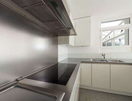 steel: modern house, stove top of a domestic kitchen