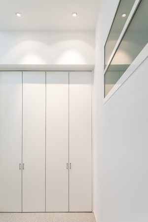 closet door: interior of a modern building, detail corridor with closets