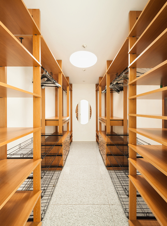 checkroom: wide wooden dressing room, interior of a modern house Stock Photo