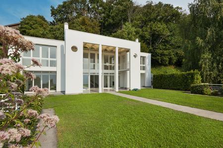 external: green garden of a white modern villa, external Stock Photo