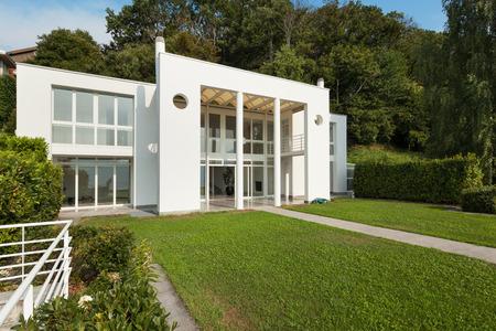 housing styles: green garden of a white modern villa, external Stock Photo