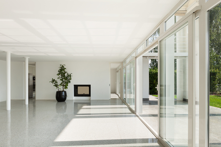 Architecture, interior of a modern house, wide hall with windows