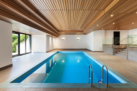 indoors: luxury apartment with indoor pool, wooden ceiling Stock Photo