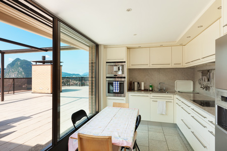 kitchen counter top: Interior of a modern apartment, domestic kitchen with terrace