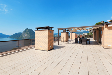 penthouse: Architecture, wide empty terrace of a penthouse, sun day