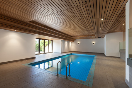 wall design: luxury apartment with indoor pool, wooden ceiling Stock Photo