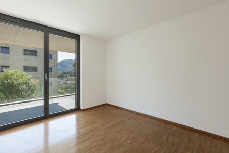 balcony design: interior of an apartment, empty living room with balcony, parquet floor
