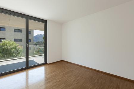balcony door: interior of an apartment, empty living room with balcony, parquet floor