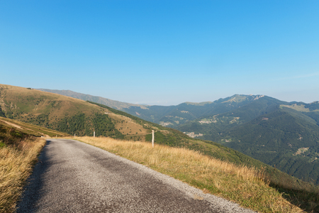 baro: Swiss mountain landscape, road through pastures