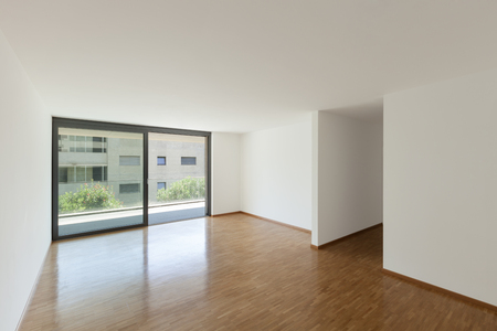 house windows: interior of an apartment, empty living room with balcony, parquet floor