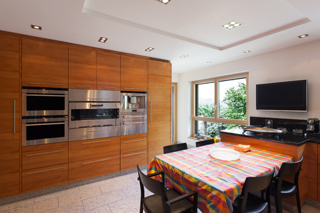 Interior of a modern apartment, wide domestic kitchen, cabinet with appliances Stockfoto