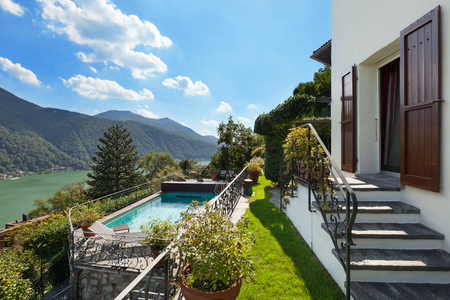 lake house: Nice terrace with swimming pool of house overlooking the lake