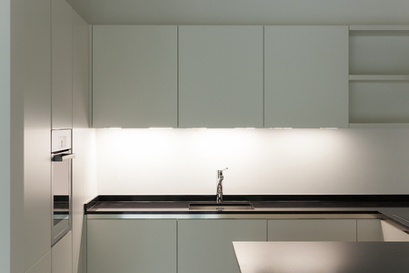 white light: interior of new apartment, white domestic kitchen