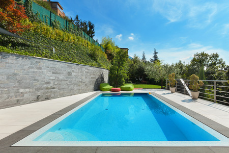 pool water: beautiful  house with swimming pool, summer day Stock Photo