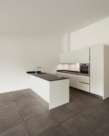 in the floor: interior of new apartment, white domestic kitchen