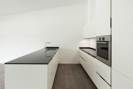 domestic: interior of new apartment, white domestic kitchen
