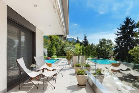 veranda: Modern house, beautiful terrace with swimming pool Stock Photo