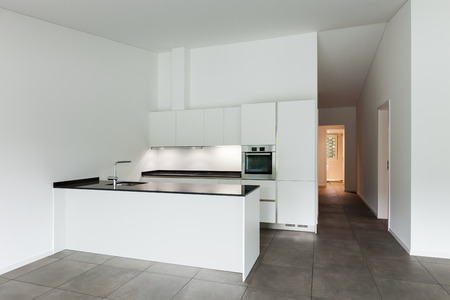 kitchen island: interior of new apartment, white domestic kitchen