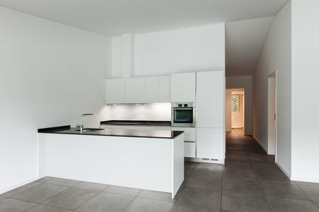 cucina moderna: interior of new apartment, white domestic kitchen