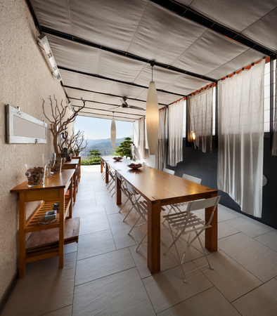 domestic kitchen: Interior of house, domestic kitchen with long wooden dining table