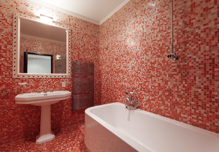 alight: Bathroom with red tiles and a bathtub Stock Photo