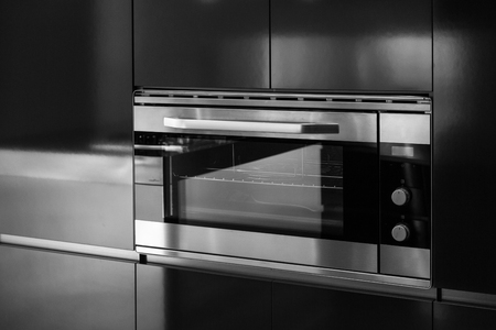 built: Detail of oven of domestic kitchen closed Stock Photo