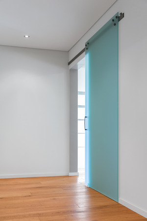slide glass: Hallway with glass door, modern contemporary home Stock Photo