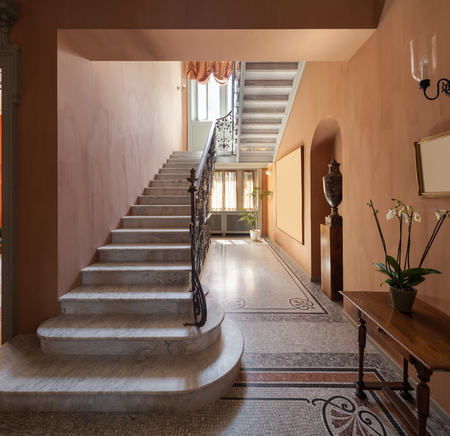 Hall with mosaic floor in luxury mansion , staircase Stock Photo