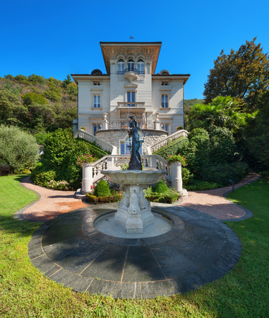 mansion: beautiful classical mansion surrounded by a park, outdoors