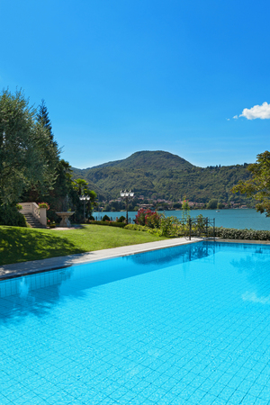 house exterior: external of a villa, beautiful swimming pool overlooking the lake