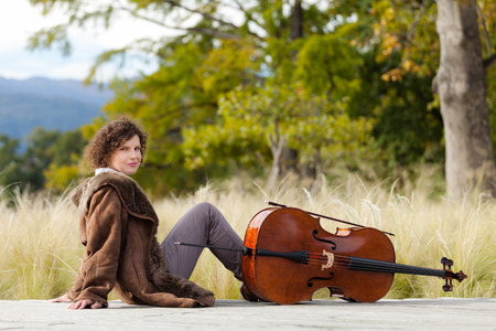 cellist: Portrait of young cellist, outdoors Stock Photo