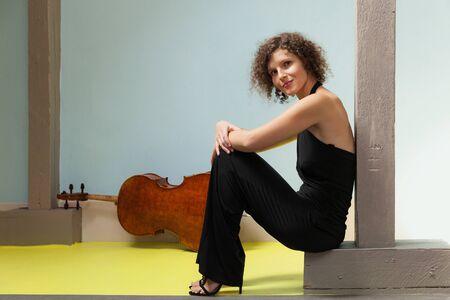 cellist: Portrait of young cellist, interior Stock Photo