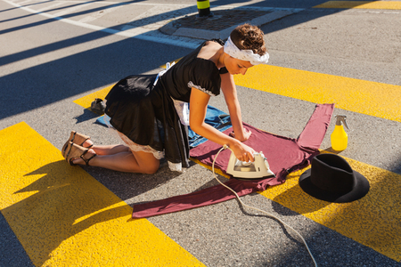 asphalt: Maid Service stretches in the road on the pedestrian crossing Stock Photo